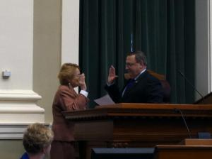 Governor LePage administers the oath of Office to Attorney General Janet T. Mills of Farmington.