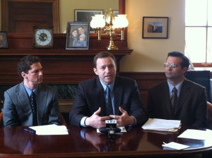 Speaker of the House Mark Eves (N Berwick) addressing media, flanked by Senate President Justin Alfond (Portland) and House Majority Leader Seth Berry (Bowdoinham)