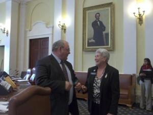 Senator Doug Thomas (R- Somerset)  congratulates Rep. Soctomah after the vote in the Senate.