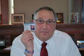 Gov. Paul LePage displays his concealed weapons permit in this photograph released by his office on Thursday, Feb. 14, 2013. (photo via BDN)