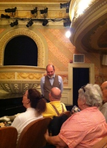 "Mark S. Cartier (""Stage Manager"") speaks with TAM audience members before the beginning of the play."