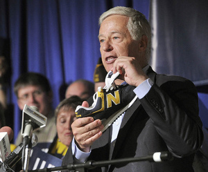 U.S. Representative Mike Michaud announced his candidacy for Governor at a press conference held at the Franco-American Heritage Center in Lewiston on Thursday. Michaud, a proponent of Maine made products, holds a pair of New Balance shoes. Morning Sentinel Staff photo by John Ewing