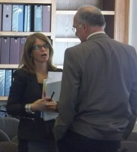 DHHS Commissioner Mary Mayhew talks with Rep Dennis Keschl (R-Belgrade) prior to emergency meeting with AFA and HHS committees.