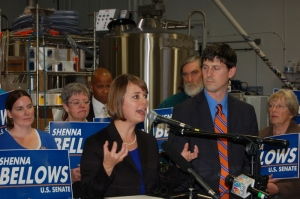 Maine U.S. Senate Democratic candidate Shenna Bellows addresses supporters and media at Portland's Rising Tide Brewing Company, as her husband Brandon Baldwin looks on.