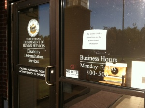 "Front doors at Maine Department of Health and Human Services Disability Determination Office in Winthrop, 10/8/13.  Sign reads: ""The Maine DDS is closed due to the government shutdown."""