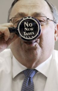 "Maine Gov. Paul LePage takes a sip from a coffee mug displaying a ""no new taxes"" message, April 27, 2012. (AP Photo/Pat Wellenbach)"