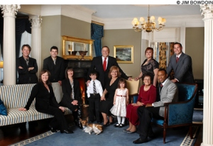 WITH THE WHOLE FAMILY The official family portrait of Governor Paul R. LePage and First Lady Ann LePage; their five adult children, Lindsay, Lisa, Lauren, Paul, and Devon; their grandchildren, Nicholas and Olivia; and Baxter the dog. (Photo @Jim Bowdoin, via Portland Phoenix)