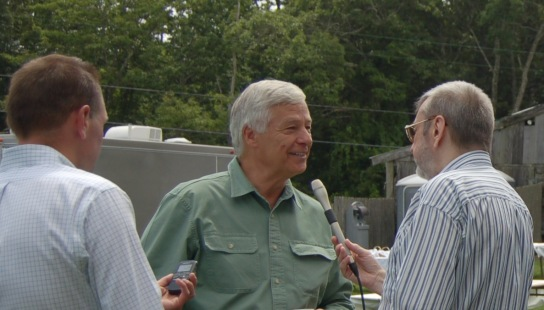 Democratic gubernatorial candidate U.S. Representative Mike Michaud speaks with MPBN and PPH reporters before the MDP Muskie Lobster Bake in Freeport.