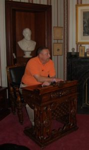 Governor Paul LePage sits at Governor James G. Blaine's Congressional desk.