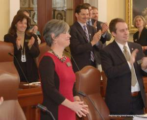 State Senator Cathy Breen (D-Cumberland) is welcomed by Senate after taking oath of office.