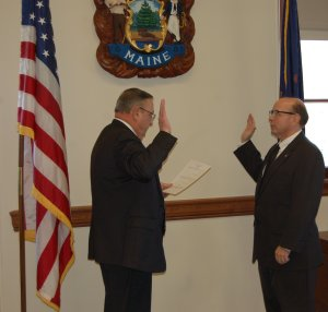 Governor Paul LePage administers the Oath of Office to Secretary of State Matt Dunlap privately in the governor's Cabinet Room.