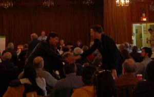 Jackson and Bartlett shake hands at December MDP state committee meeting in Augusta.